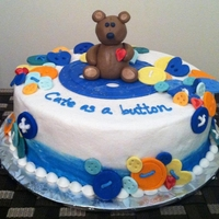 Cute As A Button Buttercream icing with fondant bear and buttons