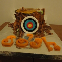 Tree Stump / Archery Target Cake.  Vanilla butter cake (did several different colours in 4 layers). Covered in fondant icing with everything edible (made from fondant).Icing...
