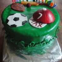 Sports Theme Cake   Vanilla butter cake, covered with fondant and fondant decorations.
