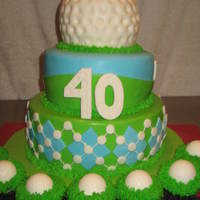 Golf Cake  Ideas taken from fellow CC'ers. Thank You. Yellow cake with Lemon Curd filling and vanilla BC. Covered in MMF. Top layer is yellow...