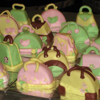 Individual Mini Cake Purses Colors made to match the clients decor. Yellow Cake with Vanilla Bean BC. Covered in MMF.