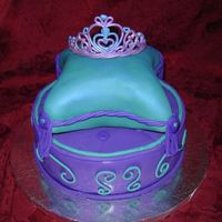 Elora's Birthday Cake  10 inch bottom and 8 inch top carved. White cake frosted in white buttercream and covered with Satin Ice fondant. Done for a 5 year old&#...