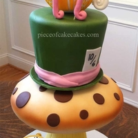 Alice Cake Alice in wonderland cake. Mushroom stem RKT. Fondant covered cakes with fondant accents