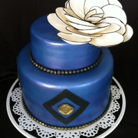 Royal Flower Cake Fondant covered chocolate cake with gumpaste accents. Gumpaste fantasy flower. TFL!