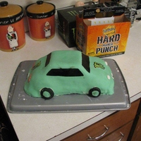 21St Birthday Ricer Cake   homemade fondant, rice krispy treat wheels, windows painted on with black food coloring.