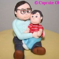 Grandpa And Grandson Birthday Topper Figurine of a grandpa and grandson birthday cake topper. The toppers are made from fondant except for the spectacles :) thanks for looking...