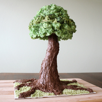 Tree Cake The treetop is angel food cake, dyed green, then accented with gel food coloring. The trunk is rice krispie treats covered in a mixture of...