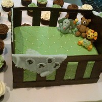 Baby Shower Crib Cake With Fondant Figurines Sheet And Baby Blanket Crib Made Of Modeling Chocolate Accompanied By Buttercream Cupcakes Baby shower crib cake with fondant figurines, sheet and baby blanket. Crib made of modeling chocolate. Accompanied by buttercream cupcakes...