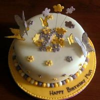 Daisies_And_Butterflies.jpg almond cake covered in marziapan and sugarpaste. Flowerpaste butterflies and sugarpaste dasies