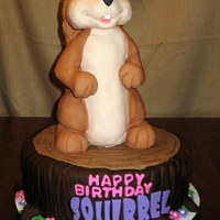 "Squirrel Birthday Cake SQUIRREL IS MADE FROM MOLDED RICE KRISPIE TREATS COVERED IN FONDANT. THE CAKE IS THREE 14"" CHOCOLATE ROUND CAKES WITH CHOCOLATE..."