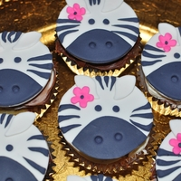 Zebra Cupcake Toppers Made these for my niece's zebra themed birthday party. The inside was zebra stripped too.