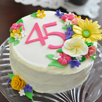 Darlene's 45Th Birthday Cake Roses, Gerber Daisy, & Plumeria. Strawberry Shortcake Cake with Whipped Cream Icing.