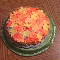 "Autumn Leaves This cake was made for a Fall Festival at a local school for a ""CakeWalk"" The flowers are yellow and orange oak leaves."