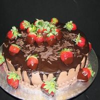 Chocolate, Ganache And Strawberry This is a 12'' chocolate cake with an 1/2'' dark chocolate ganache. Chocolate BC with pour miror chocolate ganache and...