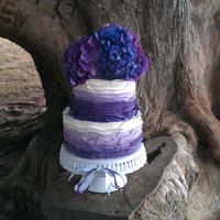 "Shades Of Purple Wedding Cake This was a ""gender reveal"" wedding cake. The inside of each tier were 3 layers, each one a different shad of pink, filled with..."