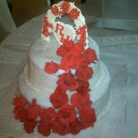 Ruby Wedding Anniversary Cake Wedding anniversary cake for a couple celebrating 40 years.....Theme was red & white.....roses made in sugar