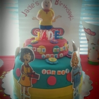Caillou Cake fondant figurines and hand painted characters.