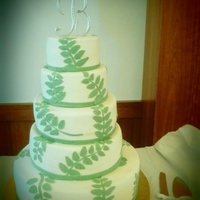 Fall Fern Theme Wedding Cake 5 tier alt. tiers of red velvet and lemon chiffon with raspberry preserve filling. fondant covered cake and hand made fondant fern leaves...