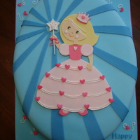 Lena's 4Th Birthday Cake Fondant princess topper on fondant covered cake made to match the partyware.