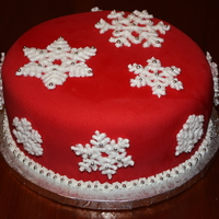Snowflakes Made for a Christmas party at school. Red velvet cake with cream cheese filling, then covered in fondant. Royal icing snowflakes dusted...