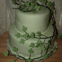 Green With Ivy The bottom tier is dark chocolate and white for the top tier. The ivy is made from gum paste.