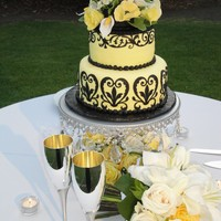 Italian Fantasy Yellow Cake, with black scrolls, sugar flowers as a topper
