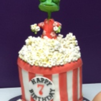 Rango Movie Cake   Cake for my DD. Popcorn bucket is Vanilla cake covered in fondant, popcorn is min marshmallows, Rango is modeling chocolate.