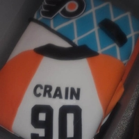 Flyers Fan  Inspired by another cake I found online. Used Wilton fondant sheets for letters, numbers and Flyers logo. Wasn't too happy with the...
