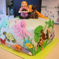 Animal Cake Chocolate cake with buttercream icing, covered in molded chocolate with molded chocolate accents. My daughter wanted 4 separate tiers for...
