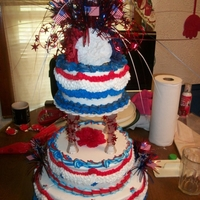 Kristy And Johns 4Th Of July Wedding Cake 14 in, 8 and 6 inch choch and vanilla rounds all decoirated in buttercream the topper i made myself.