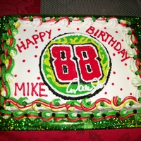 Mikes 50Th Birthday Cake choch 13x9 in cake all done in buttercream. My baby loves his nascar so i kinda did a lil theme of dale jr with his gifts and cake it...