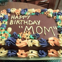 Moms Birthday Cake 13x9 inch choc cake with all buttercream decorations. She wanted fall colors she got em ! lol