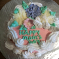 Tammys Mothers Day Cake choch 6 in round Decorated in bc flowers are buttercream and some are fondant the angel is fondant