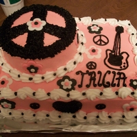 My Step Daughters 13Th Birthday Cake 13x9 inch choch cake with 6 in round as peace sign, flowers are fondant and the rest is all buttercream