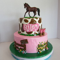 Cowgirl Birthday Cake BC icing with fondant decorations. The horse is a toy that matches the birthday girl's new horse.