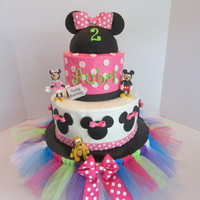 Minnie Mouse Cake BC icing with fondant decorations. The cake coordinated with the birthday girl's party dress.