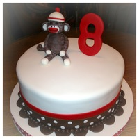 This Sock Monkey Cake Was For My Nieces 8Th Birthday It Was White Almond With Vanilla Buttercream This sock monkey cake was for my niece's 8th birthday. It was white almond with vanilla buttercream.