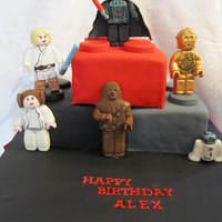 Lego Star Wars Birthday Cake This cake was for my son's 6th birthday party and included fondant figures of Darth Vader, C-3P0, R2-D2, Chewbacca, Leia, and Luke.