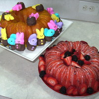 Easter Cakes! Lemon jello bunt cake with chocolate dipped peeps, and strawberry jello bunt cake decorated with fresh strawberries and blackberries. Yum...