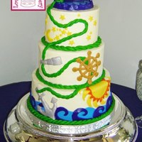 Nautical Wedding Cake This nautical-themed wedding cake has tiers with lovely symbols of direction, future, stability, and infinity tied together with a rope in...