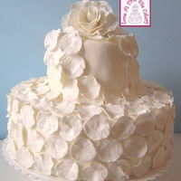 Romantic Rose Petal Wedding Cake A simple two-tiered cake for a small, initimate event. Cake was covered in fondant. 250 hand-made rose petals were created from gum paste,...