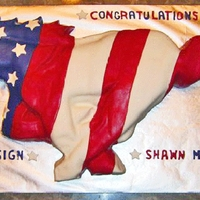 American Flag Mustang A hand-carved mustang horse cake cloaked in an American flag that was created from marshmallow fondant.