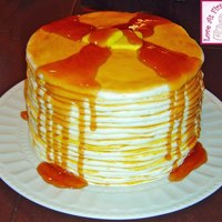 "Pancakes And Syrup A small 6"" cake covered in buttercream was surrounded by layers of marshmallow fondant pancakes. With couple pats of fondant ""..."
