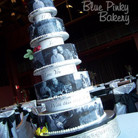 Photo Wedding Cake All sour cream white cake with buttercream icing. Edible images of the bride & groom. Silk flowers/topper provided by the bride. This...