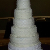 6 Tier Wedding Top 5 tiers are Cream Cheese Buttercream icing & piping. Bottom tier is fondant. We have Sour Cream White with Cream Cheese Buttercream...