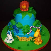 Jungle First Birthday Butter Vanilla with Buttercream Icing. Fondant/gumpaste leaves, grass, banner. Gumpaste critters.Smash cake: Butter Vanilla with...