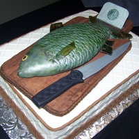 Celtic Groom's Fish Carrot cake with Cream Cheese Buttercream icing. Fondant borders. Fish is cereal treat covered with fondant and hand painted. Cutting board...
