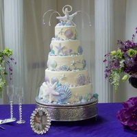 Seashell Wedding Seashell wedding cake. All seashells/starfish are gumpaste with purple and blue luster dust and a super pearl finish. All edible. All the...