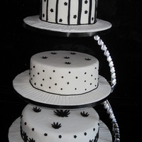 Black On White   3 tiers of black and white cakes on E stand
