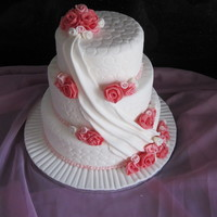 Rose And Drape   3 tier wedding cake with sugarpaste roses and textured drape